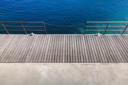 billard: Wooden pier with metal railing, top view. Mediterranean Sea coast, Corsica island