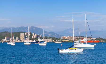 motorboats: Sailing yachts and pleasure motorboats moored in bay of Ajaccio, Corsica, France
