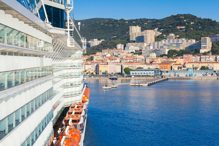 enters: Big passenger cruise ship enters the port of Ajaccio, Corsica island, France. View from a captain bridge wing