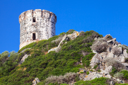stone circle: Tour Parata. Ancient Genoese tower on Sanguinaires peninsula near Ajaccio, Corsica island, France