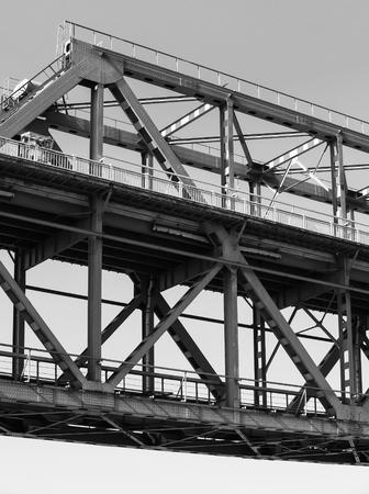 iron: Steel truss bridge construction fragment, black and white photo