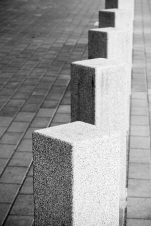 bollards: Abstract architecture composition, white square bollards in a row