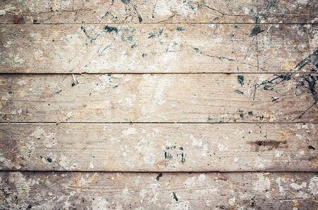 Pared de madera vieja sucio con salpicaduras de pintura, textura de fondo