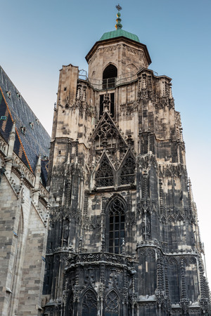 saint stephen cathedral: Tower of St. Stephen Cathedral or Stephansdom in Vienna, Austria. Dark evening natural illumination Stock Photo