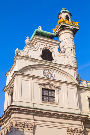 st charles: St. Charles Church in Vienna, Austria. Vertical facade fragment over blue sky