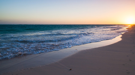beach panorama: Colorful sunrise on Atlantic ocean coast. Dominican republic, Punta Cana Stock Photo