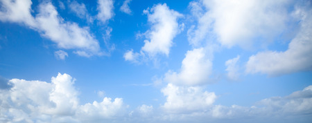 Natural blue cloudy sky. Panoramic background photo texture