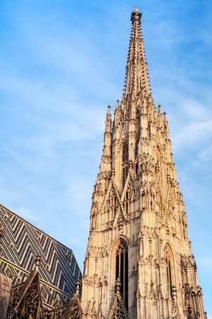 stephen: St. Stephen Cathedral or Stephansdom in Vienna, Austria. Spire over cloudy sky Stock Photo