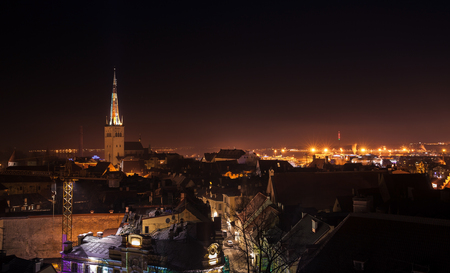 spire: Cityscape of old Tallinn at night, St Olaf Church spire with illumination