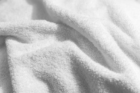 White natural cotton towel  background photo with selective focus