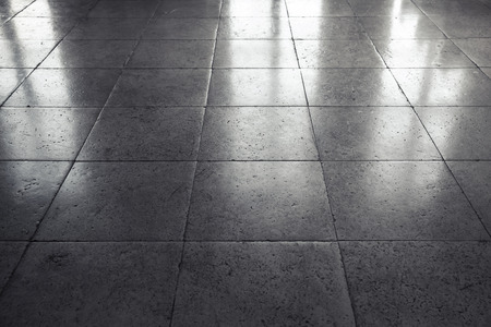 Shining gray stone floor tiling, background texture with perspective effect Stock Photo
