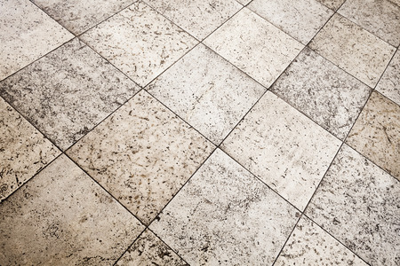 tiling: Old brown gray stone floor tiling, background texture with perspective effect