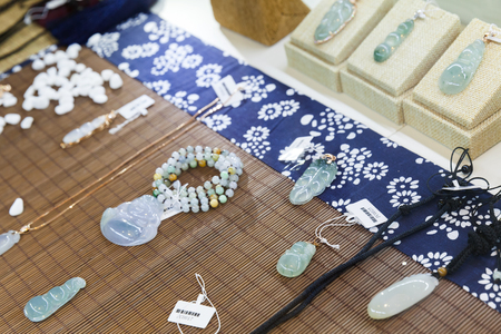 nephritis: Hangzhou, China - December 2, 2014: Traditional Chinese stone amulets made of jade lay on the counter in gemstones shop