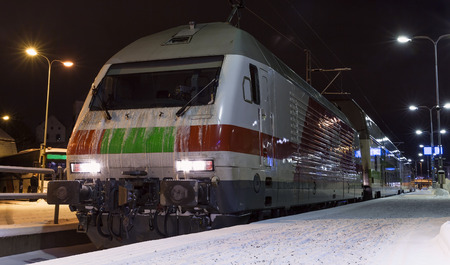 turku: Modern passenger train on the railway station at night. Turku, Finland