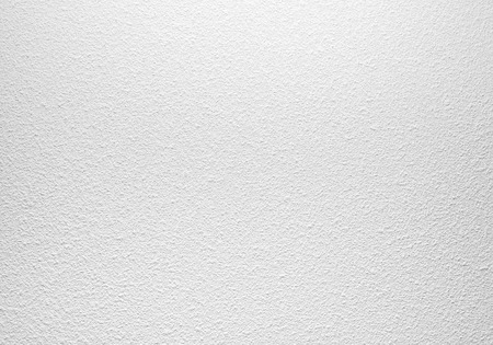 backdrop design: Empty white concrete wall with plaster relief pattern, background photo texture Stock Photo