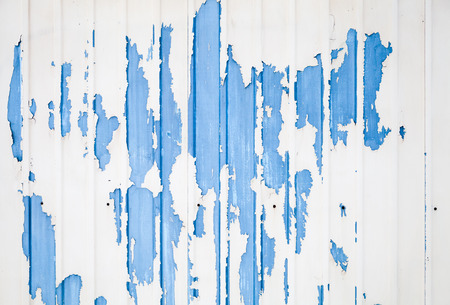 metal wall: Blue ridged metal wall texture with damaged white paint layer Stock Photo