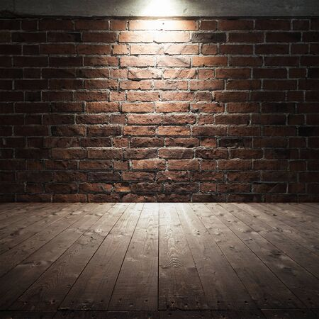 tile wall: Abstract dark interior background with wooden floor and red brick wall with spot light illumination
