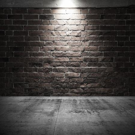 Abstracte donkere interieur achtergrond met betonnen vloer en bakstenen muur met spot light verlichting
