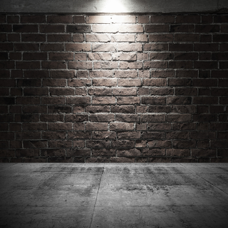 Abstract dark interior background with concrete floor and brick wall with spot light illumination