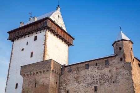 herman: Herman castle facade fragment over blue sky. Narva. Estonia