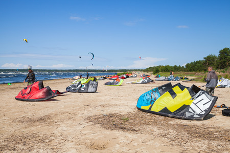 kiter: Sosnovy Bor, Russia - July 19, 2015: Kitesurfers on the beach prepare sport equipment for riding. Gulf of Finland, Russian coast Editorial