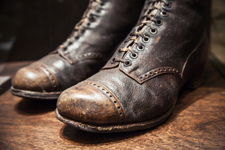 genuine leather: Old used shoes made of genuine leather, close up photo with selective focus