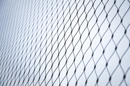 fence: Steel chain link fence background texture with selective focus