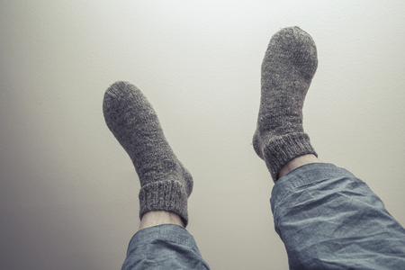 tonal: Male feet in gray woolen socks, retro style tonal correction photo filter Stock Photo