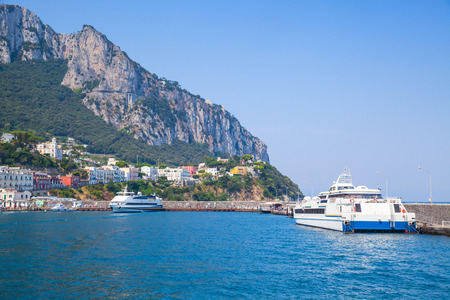 ferries: Main port of Capri island, Italy. Passenger ferries moored in harbor