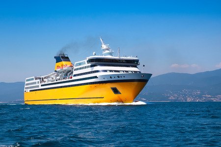 Big yellow passenger ferry goes on the Mediterranean Sea near Corsica island, France Stock Photo