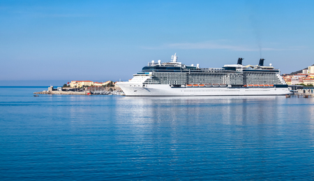 cruiseliner: White luxury cruise ship moored in Ajaccio port, Corsica island, France Stock Photo