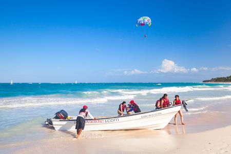 Punta Cana, Dominican republic - January 14, 2015: Ordinary tourists enjoying water sport in Punta Cana, Dominican Republic
