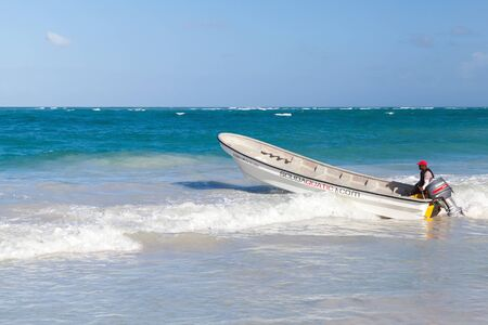 cana: Punta Cana, Dominican republic - January 14, 2015: Pleasure motorboat with local driver goes along the beach in Punta Cana, Dominican Republic Editorial