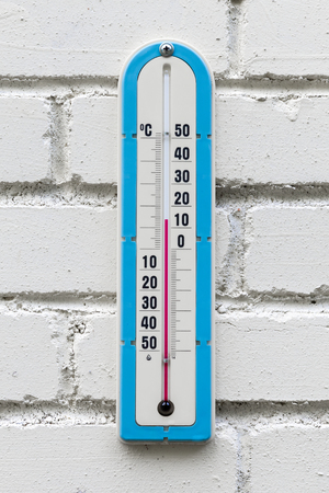 celsius: Closeup photo of alcohol thermometer showing outdoor temperature in degrees Celsius Stock Photo