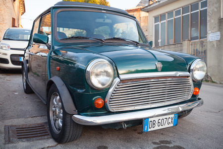 mk: Fermo, Italy - February 8, 2016: Dark green Austin Mini Cooper Mk III. This modification of Mini is a small economy car made by the British Motor Corporation between 1969 and 1976