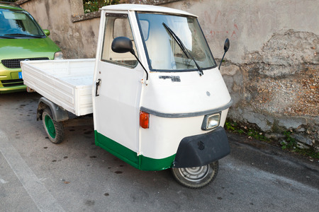 tm: Fermo, Italy - February 8, 2016:  White Ape TM P 50 a three-wheeled light commercial vehicle produced since 1948 by Piaggio