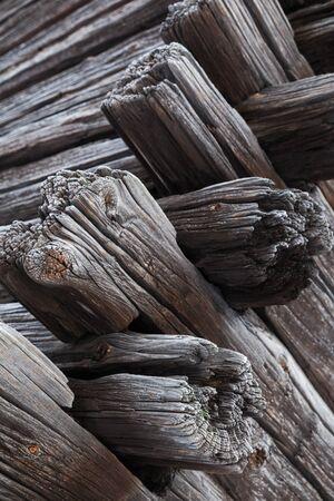 corner house: Corner wooden construction, old dark wooden house made of logs