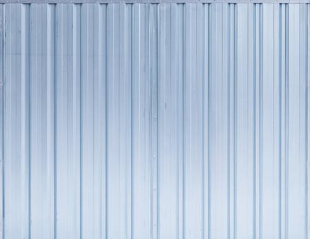 ridged: Shining blue ridged steel wall, background photo texture