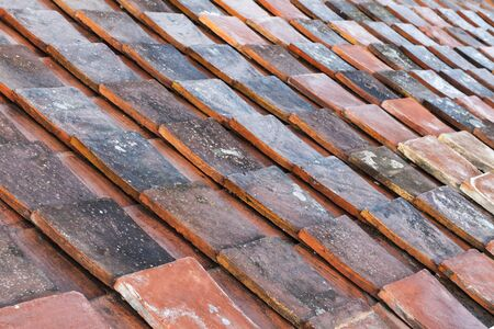 tiling: Old weathered red roof tiling background texture