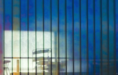 semitransparent: Colorful office wall made of semitransparent glass, background photo texture