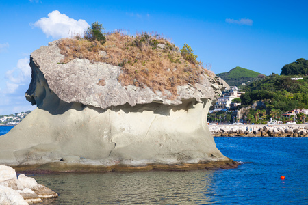 il: Il Fungo. The famous rock in mushroom shape. Lacco Ameno resort town, Ischia island, Italy