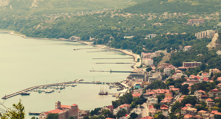 tonal: Balchik resort town cityscape, coast of Black Sea, Bulgaria. Warm tonal correction photo filter, old style effect