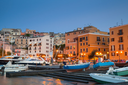 motorboats: Old port with moored motorboats and yachts. Night cityscape of Gaeta town, Italy