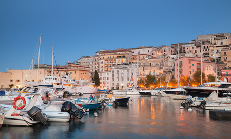 motorboats: Port with moored motorboats and pleasure yachts. Night cityscape of Gaeta town, Italy
