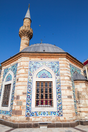 camii: Ancient Camii mosque facade and minaret. Konak square, Izmir, Turkey Stock Photo