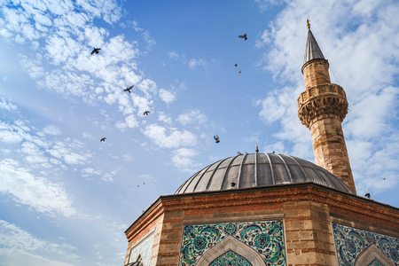 camii: Doves fly over Ancient Camii mosque. Konak square, Izmir, Turkey Stock Photo