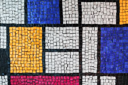 Stone tiling mosaic, made of small colorful square glass fragments. Background texture