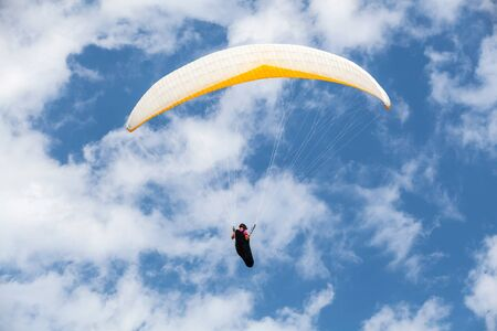 paraglider: Amateur paraglider in blue sky with clouds Stock Photo