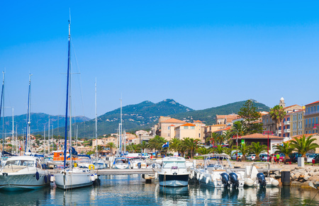 motor boats: Pleasure motor boats and sailing yachts are moored in marina of Propriano, South Corsica, France
