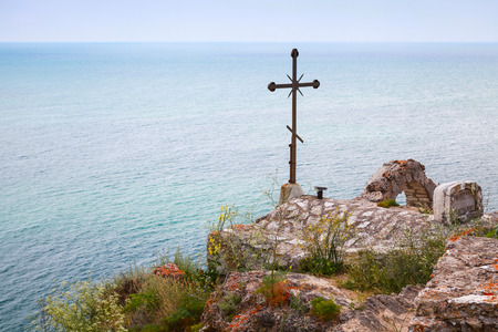 headland: Balchik, Bulgaria - July 18, 2014: Cross on the roof of chapel Sveti Nikola at the cape tip. Kaliakra headland